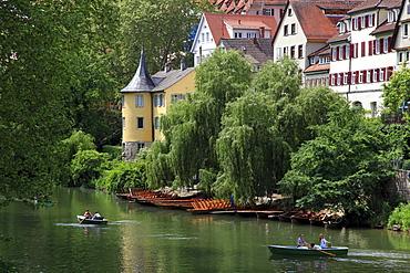 Rowboats at Neckar river, water front with Hoelderlin tower, Tuebingen Neckar, Baden-Wuerttemberg, Germany