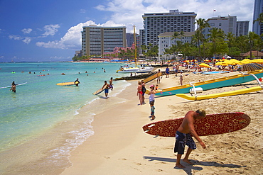 People with surfboards on the beach, Waikiki Beach, Honolulu, Oahu, Island, Hawaii, USA, America