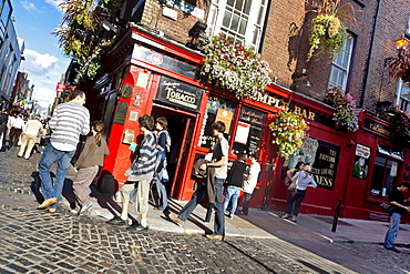Passers-by in front of an Irish pub, Temple Bar area, Dublin, County Dublin, Ireland