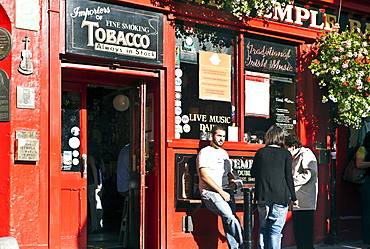 Visitors in front of an Irish pub, Temple Bar area, Dublin, County Dublin, Ireland