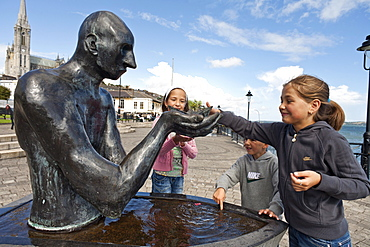 Children playing by a fountain, Cobh, County Cork, Ireland