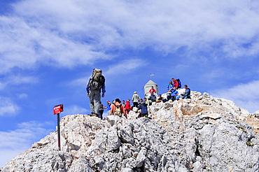 Mountaineers at Triglav summit, Triglav, Triglav national park, Julian alps, Slovenia