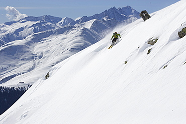 Downhill skiing in deep snow, Disentis, Oberalp pass, Canton of Grisons, Switzerland