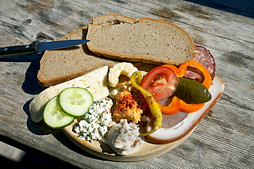 Typical snack of assorted cheese, ham, salami and bread, Loosegg Alm, Salzburger Land, Austria