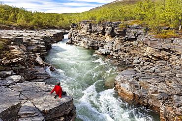 Hiker at Abisko river canyon, Abisko National Park, Lapland, northern Sweden, Sweden