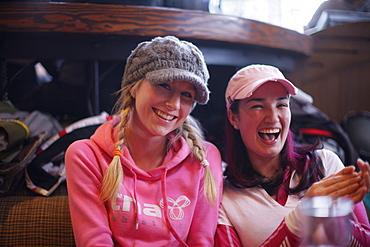 Two women laughing, Apres-ski bar, Whistler, British Columbia, Canada