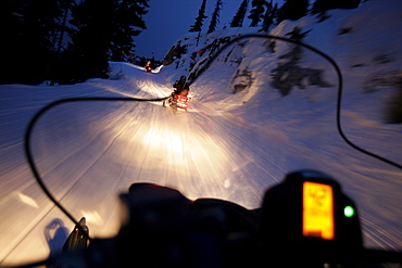 Snowmobiles on runway to mountain lodge Crystal Hut, Blackcomb Mountain, Whistler, British Columbia, Canada