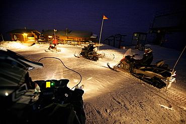 Snowmobiles near mountain lodge Crystal Hut, Blackcomb Mountain, Whistler, British Columbia, Canada