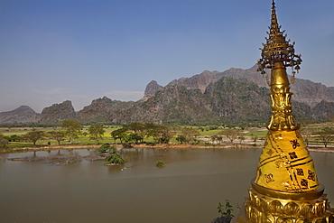 View from the Kyauk Ka Lat Pagoda on a rock, golden stupa in front of karst mountains, Kayin State, Myanmar, Birma, Asia