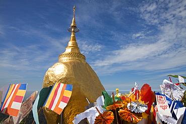 The Golden Rock with flags, Buddhistic pilgrim destination Kyaikhtiyo Pagoda, Mon State, Myanmar, Birma, Asia