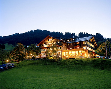 Exterior view of organic Hotel Chesa Valisa in the evening light, Hirschegg, Kleinwalsertal, Austria