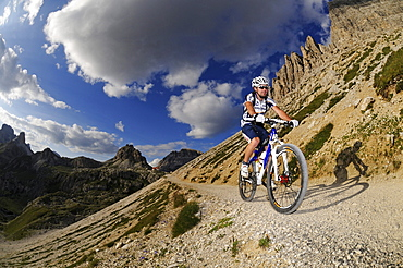 Cyclist Roland Stauder in front of Paternkofel, Hochpuster valley, South Tyrol, Dolomites, Italy, Europe