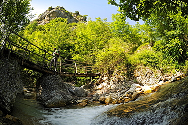 Hiker with on a bridge in the country, Caramanico Terme, Orfento gorge, Maiella National Park, Abruzzi, Italy, Europe