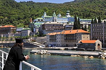 Monk on his way to Athos mountain, monastery Moni Panteleimonos, Chalkidiki, Greece