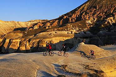 Mountain bikers in the Devrent Valley, Goereme, Cappadocia, Turkey