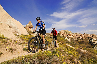 Mountain biker in the Guevercinlik valley, Goereme valley, Goereme, Cappadocia, Turkey