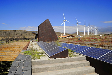 Windmills and solar collectors at ITER Eoparc, South Tenerife, Canary Islands, Spain
