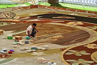 Sand carpet beeing layed out at corpus cristi, La Orotava, Tenerife, Canary Islands, Spain