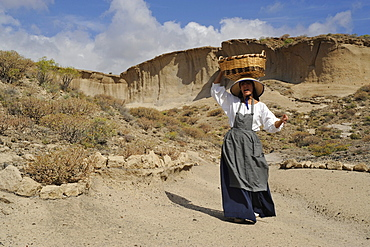 Enactment of a typical peasant woman on the way to market, Reserva San Blas, South Tenerife, Canary Islands, Spain