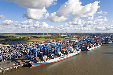 Aerial view of a container port with loading cranes, terminal and ships along the pier, Bremerhaven, Bremen, Germany