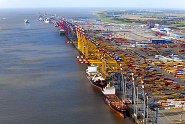 Aerial view of a container port with loading cranes, terminal and freight ships, Bremerhaven, Bremen, Germany