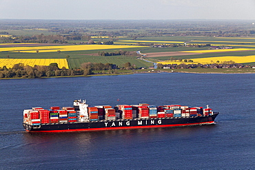 Aerial view of a Taiwanese container ship on the River Elbe, fields in the background, Lower Saxony, Germany
