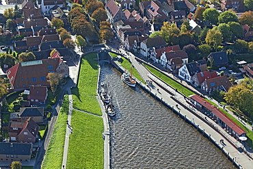 Aerial view of a fishing harbour with fishing boats, Greetsiel, Lower Saxony, Germany