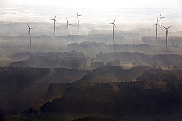 Aerial view of a wind farm in the early morning mist, Lower Saxony, Northern Germany