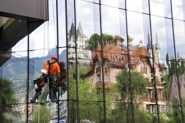 Window cleaner at glass facade, Montreux, Canton of Vaud, Switzerland