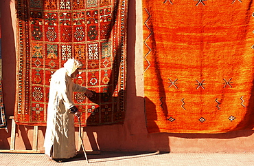 old man walking in front of carpets, Marrakech, Morroco, Africa - 1113-40816