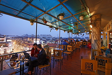 Terrace cafe with a view over the city in the evening, Hanoi, Bac Bo, Vietnam