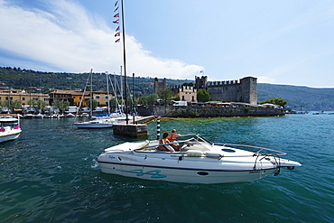 Couple in Boat, Harbor, Scaliger Castle, Torri del Benaco, Lake Garda, Veneto, Italy