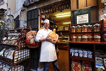 Man holding ham, Delicatessen, Torri del Benaco, Lake Garda, Veneto, Italy