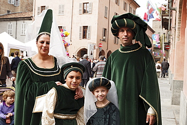 Family in traditional costumes, Palio, Alba, Langhe, Piedmont, Italy