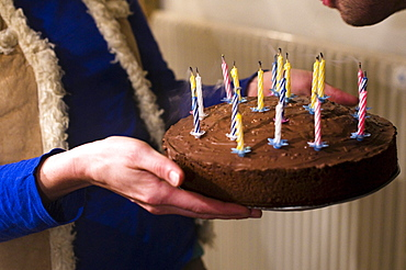 Woman holding a birthday cake