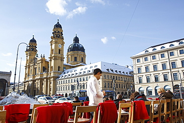 Odeonsplatz with pavement cafe and Theatine Church in winter, Munich, Bavaria, Germany