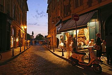 People outside a Bistro in the evening light, Place Dauphine, Isle de la Cité, Paris, France