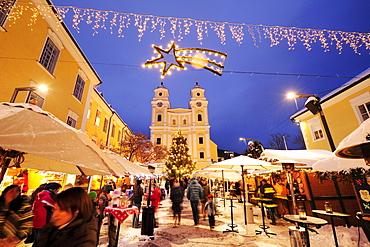 Christmas market Mondsee at night with church in background, lake Mondsee, Salzburg, Austria, Europe