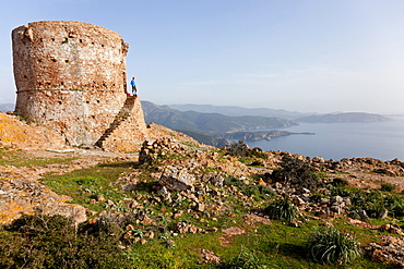 Hike to the Tower of Turghio at Capo Rosso, view over the sea from the cap, Mediterranean Sea, Porto, Corsica, France