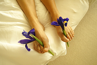 Female feet with lilies