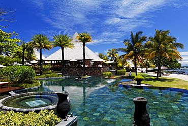 Pool and restaurant of the Shanti Maurice Resort in the sunlight, Souillac, Mauritius, Africa