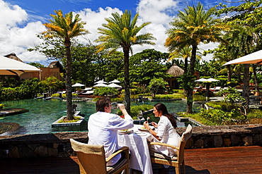 People on the terrace of the restaurant, Shanti Maurice Resort, Souillac, Mauritius, Africa