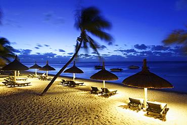 Illuminated beach of Beachcomber Hotel Paradis & Golf Club in the evening, Mauritius, Africa