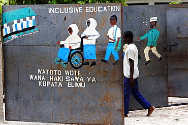 Child going through the school gate in Jambiani, Zanzibar, Tanzania, Africa