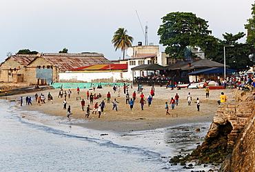 Children playing soccer on the beach in front of Mercury's restaurant, Stonetown, Zanzibar City, Zanzibar, Tanzania, Africa