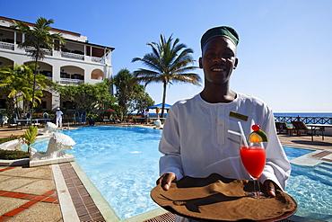 Waiter at the pool in front of Serena Inn hotel, Stonetown, Zanzibar City, Zanzibar, Tanzania, Africa