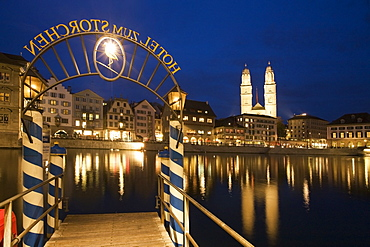 Switzerland, Zurich, old town center, river Limmat at night, Limmatquai Grossmunster, Pier Hotel Storchen