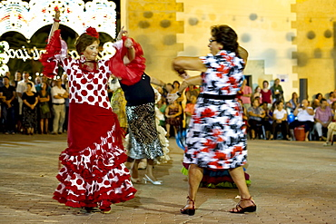Feria, blurred people dancing, Conil de la Frontera, Andalusia, Spain, Europe