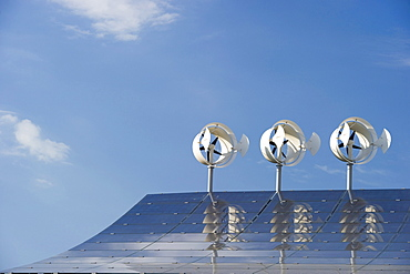 Small wind turbines and solar installations on the roof of Hotel Victoria, Freiburg im Breisgau, Baden-Wuerttemberg, Germany, Europe