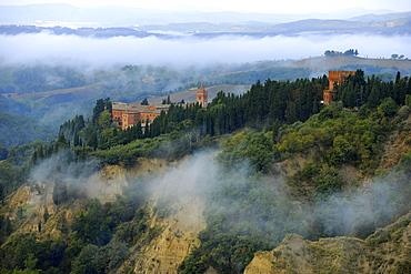 View of abbey Abbazia di Monte Oliveto Maggiore, Crete, Tuscany, Italy, Europe